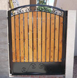 Wrought iron small yard gate with wooden backing